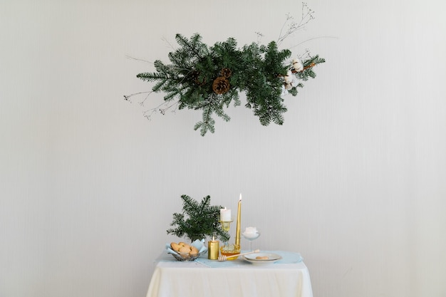 Aesthetic design for christmas with pine nobilis hanging garland, candles and table decorations