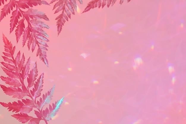 ピンクの境界線の背景に美的な葉