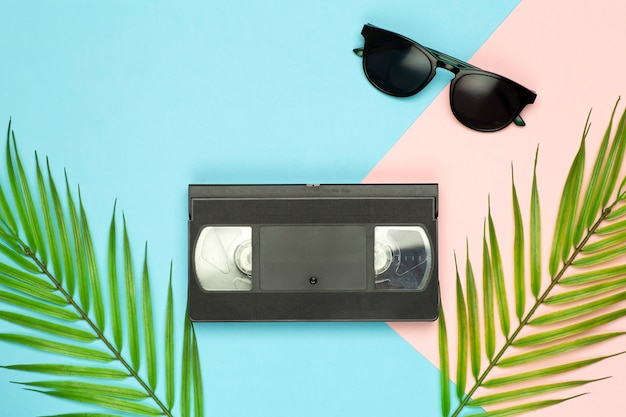 Aesthetics of the 80s and 90s. videocassette (vhs) on a color background. video, minimal, retro concept