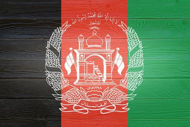 Флаг афганистана окрашены на фоне старой деревянной доски афганистан