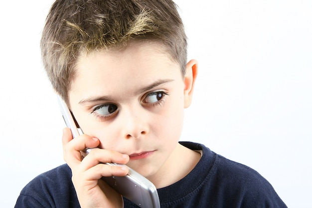 Afraid little boy speaking on the phone