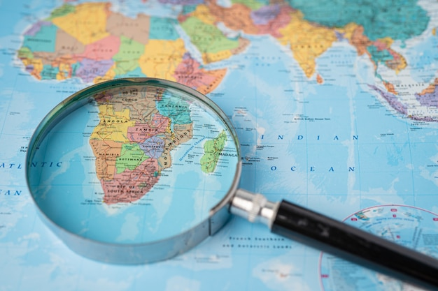 Africa, magnifying glass close up with colorful world map