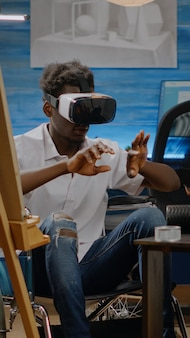 African american artist with handicap using virtual technology
