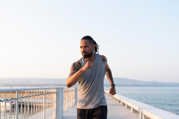 African american athlete exercising outdoors