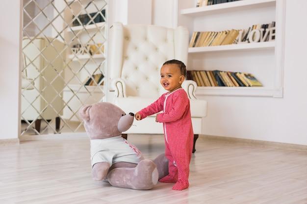 African american baby boy with teddy bear.