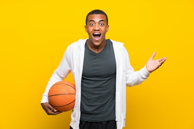 African american basketball player man with shocked facial expression