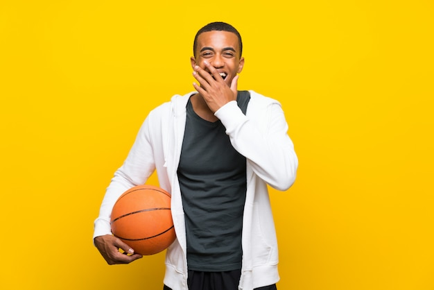 African american basketball player man with surprise facial expression