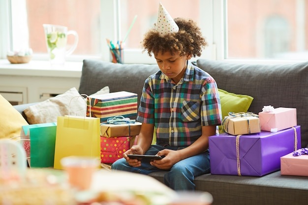 African-american boy unpacking presents