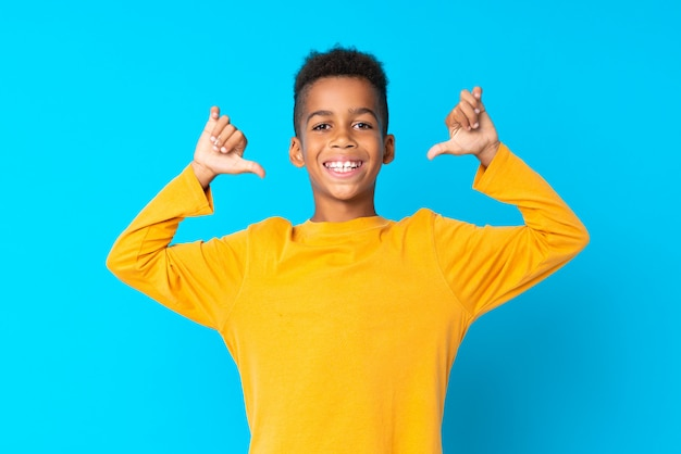African american boyblue background proud and self-satisfied