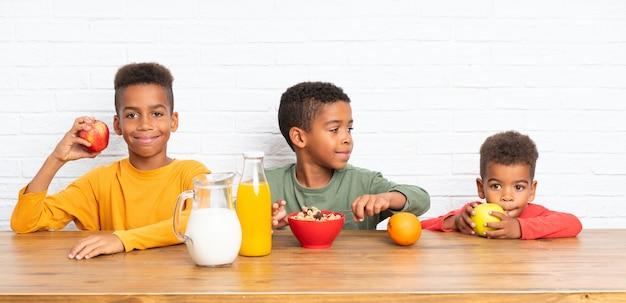 African american brothers having breakfast