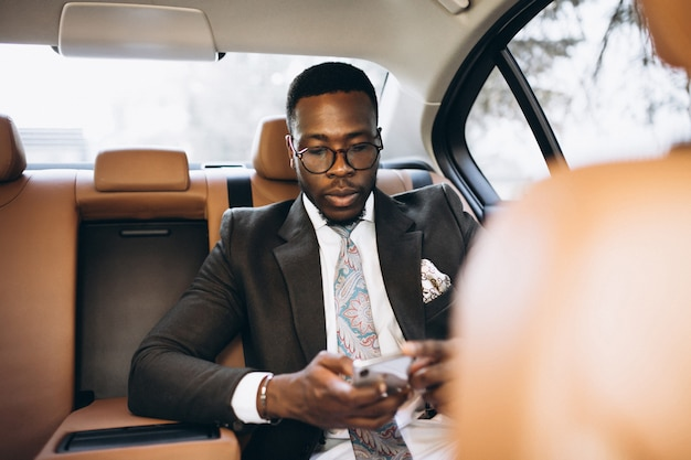African american business man in car