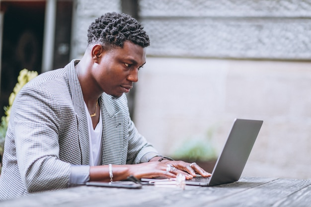 African american business man using laptop in a cafe