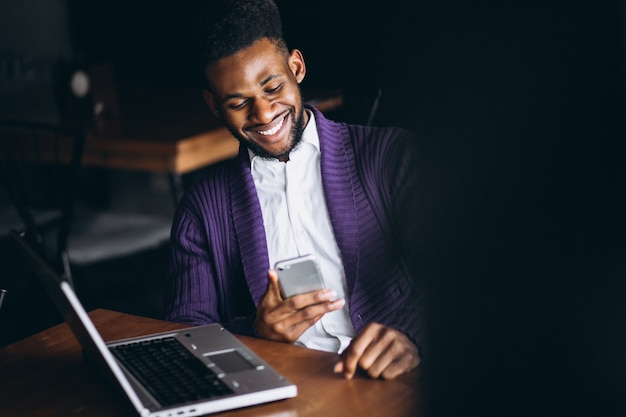 African american business man with laptop in a cafe