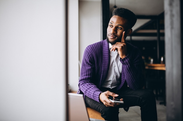 African american business man with phone in a cafe