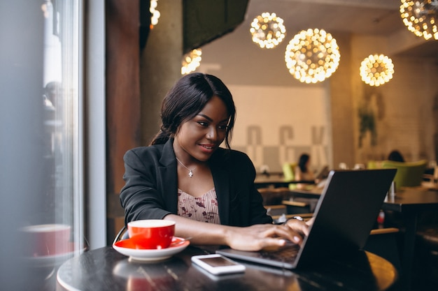 African american business woman working in a cafe