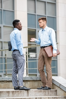African american businessman and a caucasian businessman discussing  on city