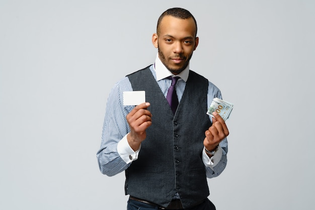 African american businessman making choice between credit card and money