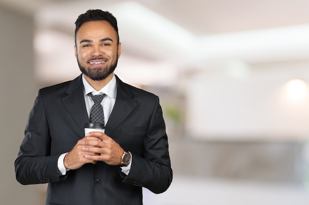 African american businessman wearing suit and holding coffee cup. coffee break