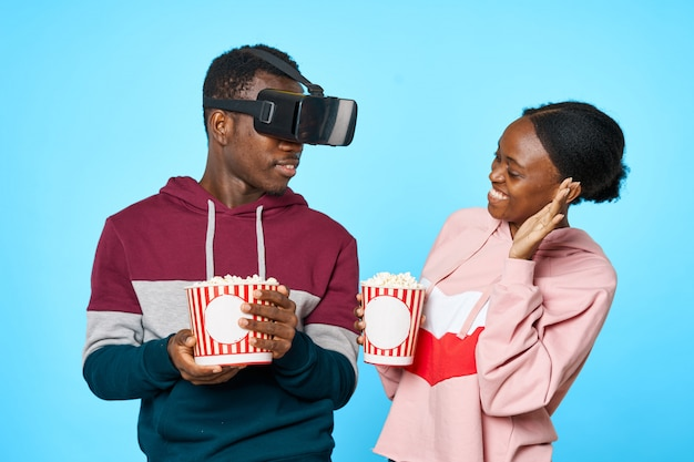African american couple eating popcorn