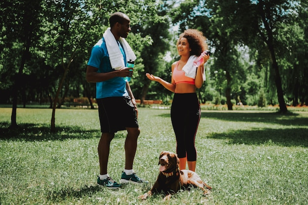 African american couple in sportswear talking