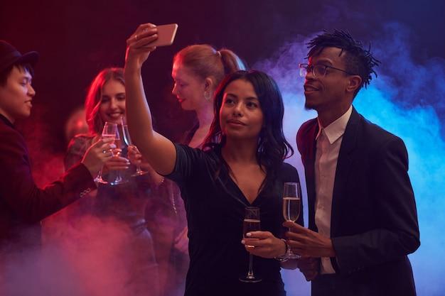 African-american couple taking selfie in nightclub