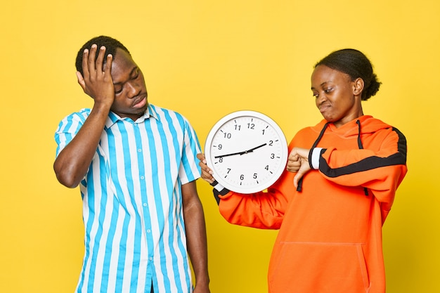 African american couple with clock