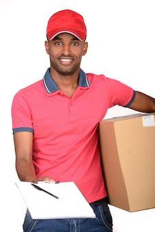 African american delivery man carrying parcel.