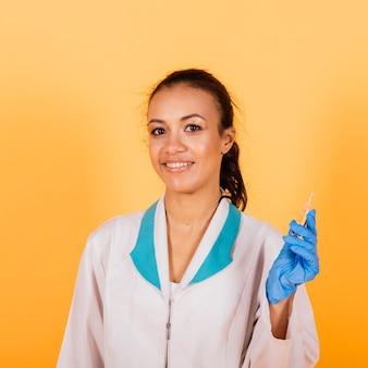 African-american doctor woman, mask, stethoskope, robe vaccine in studio