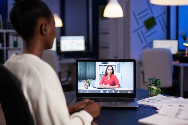 African american entrepreneur talking with remote partner