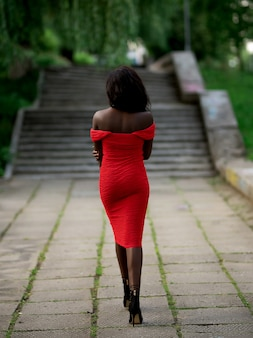 African american girl in a red dress. on the street.