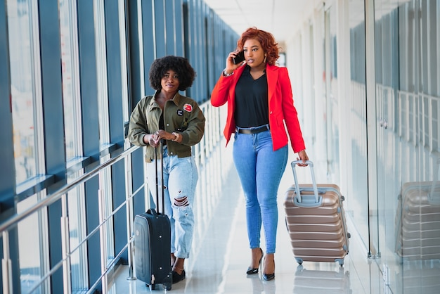 African american girlfriends travel by plane the concept of air transportation and recreation abroad