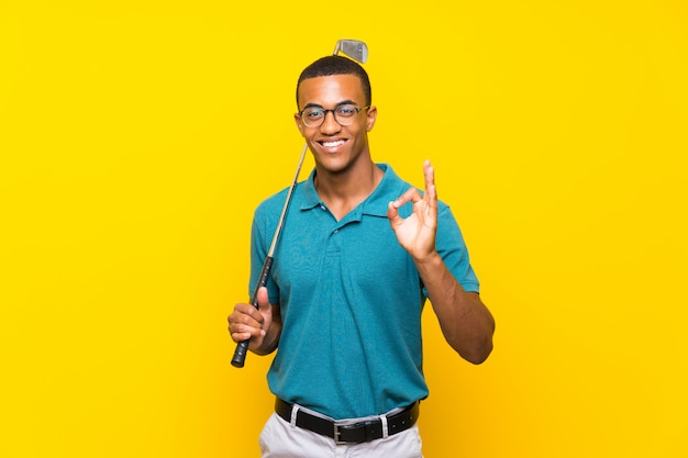 African american golfer player man showing ok sign with fingers