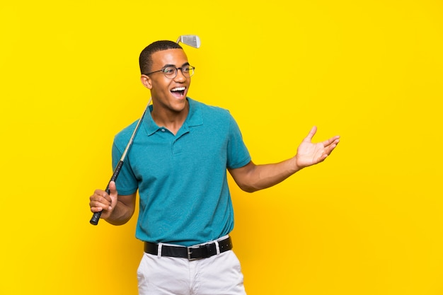 African american golfer player man with surprise facial expression