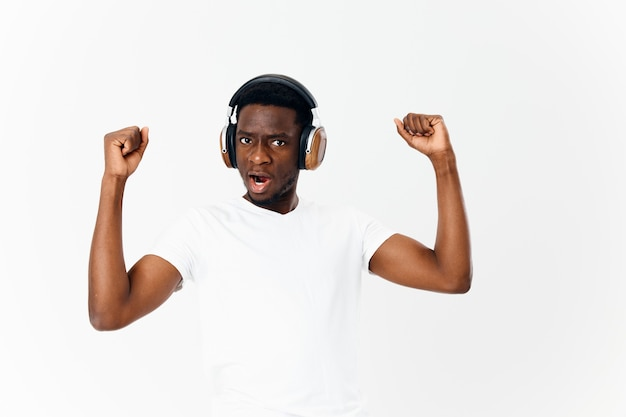 African american in headphones music lover isolated background