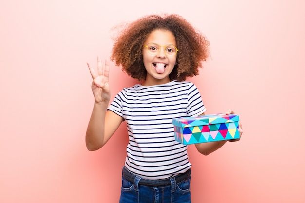 African american little girl  holding a gift box