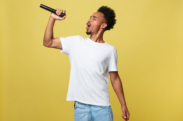 African american male singer performing with microphone.