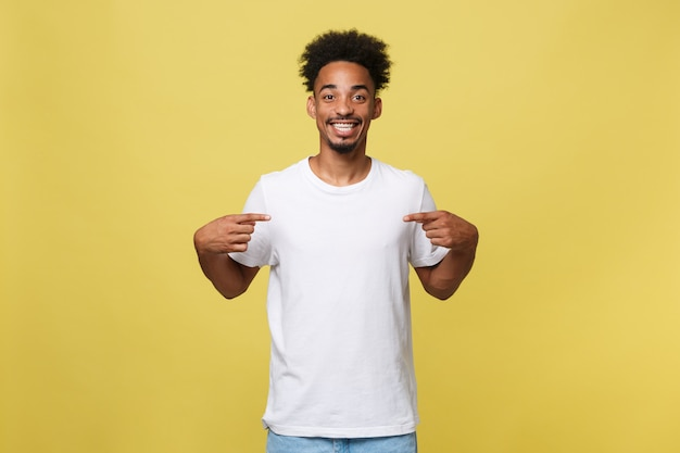 African american man in casual white shirt having excited look