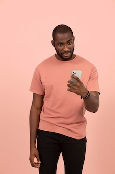 African american man checking his smartphone