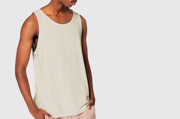 African american man in creamy tank top sleepwear shoot