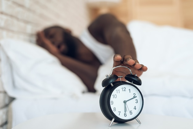 African american man does not want to wake up