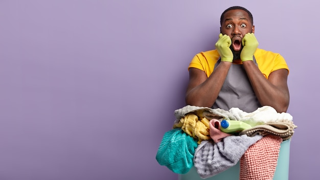 African american man doing laundry