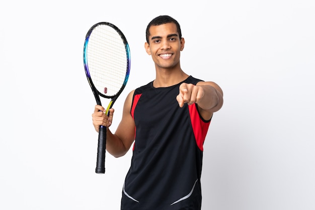 African american man over isolated white background playing tennis and pointing to the front