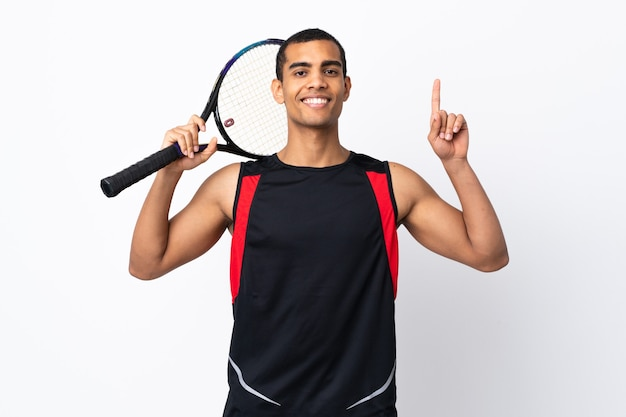 African american man over isolated white background playing tennis and pointing up