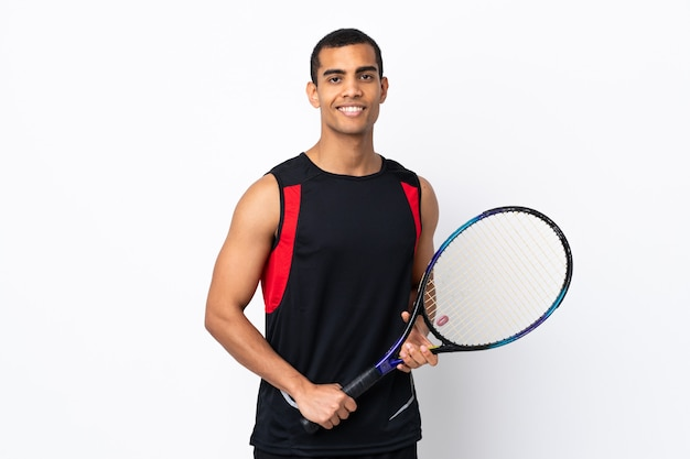 African american man over isolated white background playing tennis