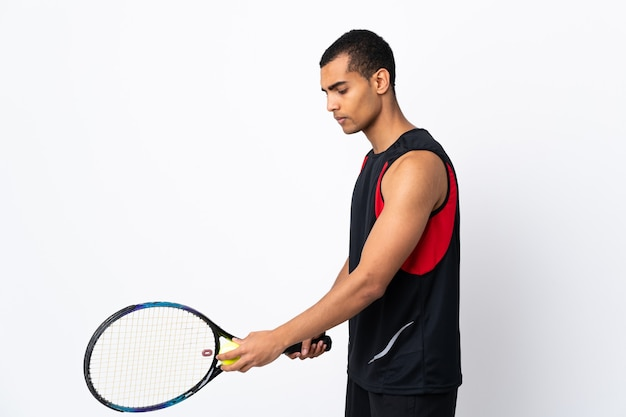 African american man on isolated white playing tennis