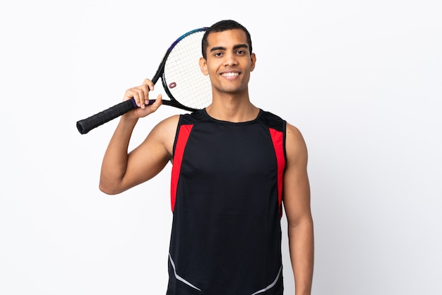 African american man over isolated white wall playing tennis
