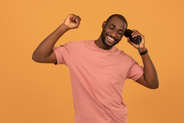 African american man listening to music on speaker