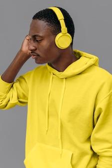 African american man listening to music through headphones