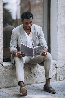 African american man reading magazine
