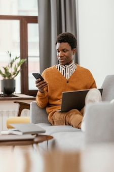 African american man remote working from home